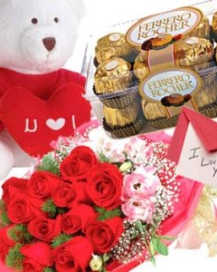 12 Roses+ 16 Ferrero and small Teddy w/pillow & valentines card